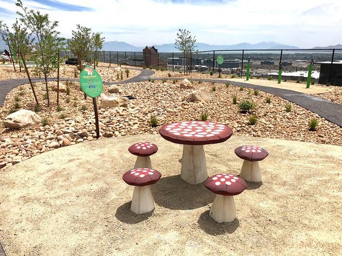 Interactive Playground Equipment Along Pathway